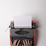 hands on typewriter